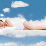 Young Woman Sleeping On Clouds